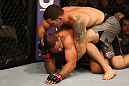 SAN JOSE, CA - JULY 11:   Chris Weidman (grey shorts) punches Mark Munoz during their middleweight bout at HP Pavilion on July 11, 2012 in San Jose, California.  (Photo by Ezra Shaw/Zuffa LLC/Zuffa LLC via Getty Images)  *** Local Caption *** Mark Munoz; Chris Weidman