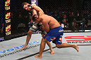 SAN JOSE, CA - JULY 11:   (R-L) Mark Munoz punches Chris Weidman during their middleweight bout at HP Pavilion on July 11, 2012 in San Jose, California.  (Photo by Ezra Shaw/Zuffa LLC/Zuffa LLC via Getty Images)  *** Local Caption *** Mark Munoz; Chris Weidman