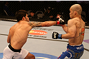 SAN JOSE, CA - JULY 11:   (L-R) Raphael Assuncao punches Issei Tamura during their bantamweight bout at HP Pavilion on July 11, 2012 in San Jose, California.  (Photo by Ezra Shaw/Zuffa LLC/Zuffa LLC via Getty Images)  *** Local Caption *** Issei Tamura; Raphael Assuncao