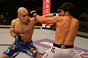SAN JOSE, CA - JULY 11:   (L-R) Issei Tamura punches Raphael Assuncao during their bantamweight bout at HP Pavilion on July 11, 2012 in San Jose, California.  (Photo by Ezra Shaw/Zuffa LLC/Zuffa LLC via Getty Images)  *** Local Caption *** Issei Tamura; Raphael Assuncao