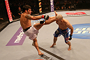 SAN JOSE, CA - JULY 11:   (L-R) Raphael Assuncao kicks Issei Tamura during their bantamweight bout at HP Pavilion on July 11, 2012 in San Jose, California.  (Photo by Ezra Shaw/Zuffa LLC/Zuffa LLC via Getty Images)  *** Local Caption *** Issei Tamura; Raphael Assuncao
