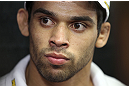 CALGARY, CANADA - JULY 18:  Renan Barao speaks to the media during the UFC 149 Open Workouts inside Champion's Creed Gym on July 18, 2012 in Calgary, Alberta, Canada.  (Photo by Jeff Bottari/Zuffa LLC/Zuffa LLC via Getty Images)