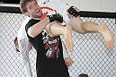 CALGARY, CANADA - JULY 18:  Mitch Clarke works out for the fans and media during the UFC 149 Open Workouts inside Champion's Creed Gym on July 18, 2012 in Calgary, Alberta, Canada.  (Photo by Jeff Bottari/Zuffa LLC/Zuffa LLC via Getty Images)