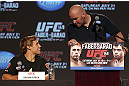 CALGARY, CANADA - JULY 19: Urijah Faber and UFC President Dana White share a moment on stage at the UFC 149 press conference at the Flames Central Sports Club on July 19, 2012 in Calgary, Alberta, Canada. (Photo by Jeff Bottari/Zuffa LLC/Zuffa LLC via Getty Images)