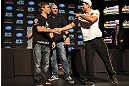 CALGARY, CANADA - JULY 19: Urijah Faber and Renan Barao shake hands after squaring off at the UFC 149 press conference at the Flames Central Sports Club on July 19, 2012 in Calgary, Alberta, Canada. (Photo by Jeff Bottari/Zuffa LLC/Zuffa LLC via Getty Images)