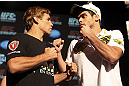 CALGARY, CANADA - JULY 19: Urijah Faber and Renan Barao square off at the UFC 149 press conference at the Flames Central Sports Club on July 19, 2012 in Calgary, Alberta, Canada. (Photo by Jeff Bottari/Zuffa LLC/Zuffa LLC via Getty Images)