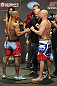 CALGARY, CANADA - JULY 20: Hector Lombard and Tim Boetsch face off at the UFC 149 weigh-in at the Scotiabank Saddledome on July 20, 2012 in Calgary, Alberta, Canada.  (Photo by Jeff Bottari/Zuffa LLC/Zuffa LLC via Getty Images)