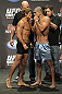 CALGARY, CANADA - JULY 20: Urijah Faber and Renan Barao square off at the UFC 149 weigh-in at the Scotiabank Saddledome on July 20, 2012 in Calgary, Alberta, Canada. (Photo by Jeff Bottari/Zuffa LLC/Zuffa LLC via Getty Images)