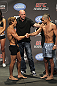 CALGARY, CANADA - JULY 20: Urijah Faber and Renan Barao shake hands after they face off at the UFC 149 weigh-in at the Scotiabank Saddledome on July 20, 2012 in Calgary, Alberta, Canada.  (Photo by Jeff Bottari/Zuffa LLC/Zuffa LLC via Getty Images)