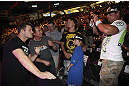 CALGARY, CANADA - JULY 20:  Michael Bisping poses for pictures after a Q&amp;A session with the fans prior to the UFC 149 weigh-in at the Scotiabank Saddledome on July 20, 2012 in Calgary, Alberta, Canada.  (Photo by Jeff Bottari/Zuffa LLC/Zuffa LLC via Getty Images)