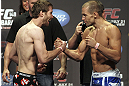 CALGARY, CANADA - JULY 20: Mitch Clarke and Anton Kuivanen face off at the UFC 149 weigh-in at the Scotiabank Saddledome on July 20, 2012 in Calgary, Alberta, Canada.  (Photo by Jeff Bottari/Zuffa LLC/Zuffa LLC via Getty Images)