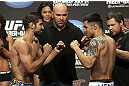 CALGARY, CANADA - JULY 20:  Antonio Carvalho and Daniel Pineda face off at the UFC 149 weigh-in at the Scotiabank Saddledome on July 20, 2012 in Calgary, Alberta, Canada.  (Photo by Jeff Bottari/Zuffa LLC/Zuffa LLC via Getty Images)