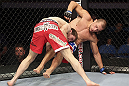CALGARY, CANADA - JULY 21:  Mitch Clarke takes down Anton Kuivanen during their lightweight bout at UFC 149 inside the Scotiabank Saddledome on July 21, 2012 in Calgary, Alberta, Canada.  (Photo by Nick Laham/Zuffa LLC/Zuffa LLC via Getty Images)