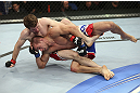 CALGARY, CANADA - JULY 21: (L-R) Mitch Clarke grapples Anton Kuivanen during their lightweight bout at UFC 149 inside the Scotiabank Saddledome on July 21, 2012 in Calgary, Alberta, Canada.  (Photo by Nick Laham/Zuffa LLC/Zuffa LLC via Getty Images)