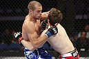 CALGARY, CANADA - JULY 21: (L-R) Anton Kuivanen attacks Mitch Clarke during their lightweight bout at UFC 149 inside the Scotiabank Saddledome on July 21, 2012 in Calgary, Alberta, Canada.  (Photo by Nick Laham/Zuffa LLC/Zuffa LLC via Getty Images)