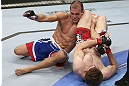 CALGARY, CANADA - JULY 21: (R-L) Mitch Clarke attempts an armbar against Anton Kuivanen during their lightweight bout at UFC 149 inside the Scotiabank Saddledome on July 21, 2012 in Calgary, Alberta, Canada.  (Photo by Nick Laham/Zuffa LLC/Zuffa LLC via Getty Images)