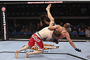 CALGARY, CANADA - JULY 21: (L-R) Mitch Clarke takes down Anton Kuivanen during their lightweight bout at UFC 149 inside the Scotiabank Saddledome on July 21, 2012 in Calgary, Alberta, Canada.  (Photo by Nick Laham/Zuffa LLC/Zuffa LLC via Getty Images)