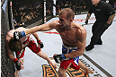 CALGARY, CANADA - JULY 21:  (R-L) Anton Kuivanen throws a punch at Mitch Clarke during their lightweight bout at UFC 149 inside the Scotiabank Saddledome on July 21, 2012 in Calgary, Alberta, Canada.  (Photo by Nick Laham/Zuffa LLC/Zuffa LLC via Getty Images)