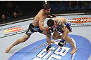 CALGARY, CANADA - JULY 21: (L-R) Antonio Carvalho lands a knockout punch on Daniel Pineda during their featherweight bout at UFC 149 inside the Scotiabank Saddledome on July 21, 2012 in Calgary, Alberta, Canada.  (Photo by Nick Laham/Zuffa LLC/Zuffa LLC via Getty Images)