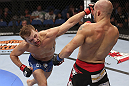CALGARY, CANADA - JULY 21: (L-R) Bryan Caraway lands a punch on Mitch Gagnon during their bantamweight bout at UFC 149 inside the Scotiabank Saddledome on July 21, 2012 in Calgary, Alberta, Canada.  (Photo by Nick Laham/Zuffa LLC/Zuffa LLC via Getty Images)