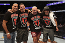 CALGARY, CANADA - JULY 21: Ryan Jimmo (second from right) celebrates with his corner after defeating Anthony Perosh during their light heavyweight bout at UFC 149 inside the Scotiabank Saddledome on July 21, 2012 in Calgary, Alberta, Canada.  (Photo by Nick Laham/Zuffa LLC/Zuffa LLC via Getty Images)