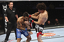 CALGARY, CANADA - JULY 21: (R-L) Roland Delorme lands a knee to the chin of Francisco Rivera during their bantamweight bout at UFC 149 inside the Scotiabank Saddledome on July 21, 2012 in Calgary, Alberta, Canada.  (Photo by Nick Laham/Zuffa LLC/Zuffa LLC via Getty Images)