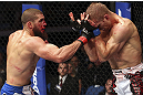 CALGARY, CANADA - JULY 21: (L-R) Court McGee throws a punch at Nick Ring during their middleweight bout at UFC 149 inside the Scotiabank Saddledome on July 21, 2012 in Calgary, Alberta, Canada.  (Photo by Nick Laham/Zuffa LLC/Zuffa LLC via Getty Images)