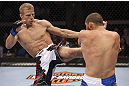 CALGARY, CANADA - JULY 21: (L-R) Nick Ring lands a kick to Court McGee during their middleweight bout at UFC 149 inside the Scotiabank Saddledome on July 21, 2012 in Calgary, Alberta, Canada.  (Photo by Nick Laham/Zuffa LLC/Zuffa LLC via Getty Images)