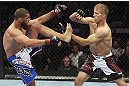 CALGARY, CANADA - JULY 21: (L-R) Court McGee exchanges contact with Nick Ring during their middleweight bout at UFC 149 inside the Scotiabank Saddledome on July 21, 2012 in Calgary, Alberta, Canada.  (Photo by Nick Laham/Zuffa LLC/Zuffa LLC via Getty Images)