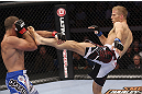 CALGARY, CANADA - JULY 21: (L-R) Court McGee blocks a kick from Nick Ring during their middleweight bout at UFC 149 inside the Scotiabank Saddledome on July 21, 2012 in Calgary, Alberta, Canada.  (Photo by Nick Laham/Zuffa LLC/Zuffa LLC via Getty Images)