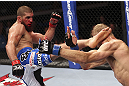 CALGARY, CANADA - JULY 21:  Court McGee lands a kick to the head of Nick Ring during their middleweight bout at UFC 149 inside the Scotiabank Saddledome on July 21, 2012 in Calgary, Alberta, Canada.  (Photo by Nick Laham/Zuffa LLC/Zuffa LLC via Getty Images)
