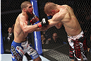 CALGARY, CANADA - JULY 21:  Court McGee throws a punch at Nick Ring during their middleweight bout at UFC 149 inside the Scotiabank Saddledome on July 21, 2012 in Calgary, Alberta, Canada.  (Photo by Nick Laham/Zuffa LLC/Zuffa LLC via Getty Images)