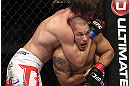 CALGARY, CANADA - JULY 21: (R-L) Chris Clements is caught in a choke hold from Matthew Riddle during their welterweight bout at UFC 149 inside the Scotiabank Saddledome on July 21, 2012 in Calgary, Alberta, Canada.  (Photo by Nick Laham/Zuffa LLC/Zuffa LLC via Getty Images)