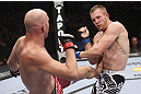 CALGARY, CANADA - JULY 21: (L-R) Brian Ebersole lands a kick at the body of James Head during their welterweight bout at UFC 149 inside the Scotiabank Saddledome on July 21, 2012 in Calgary, Alberta, Canada.  (Photo by Nick Laham/Zuffa LLC/Zuffa LLC via Getty Images)