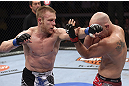 CALGARY, CANADA - JULY 21: (L-R) James Head throws a punch at Brian Ebersole during their welterweight bout at UFC 149 inside the Scotiabank Saddledome on July 21, 2012 in Calgary, Alberta, Canada.  (Photo by Nick Laham/Zuffa LLC/Zuffa LLC via Getty Images)