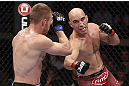 CALGARY, CANADA - JULY 21: (R-L) Brian Ebersole throws a punch at James Head during their welterweight bout at UFC 149 inside the Scotiabank Saddledome on July 21, 2012 in Calgary, Alberta, Canada.  (Photo by Nick Laham/Zuffa LLC/Zuffa LLC via Getty Images)