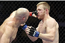 CALGARY, CANADA - JULY 21: (L-R) Brian Ebersole lands a punch on the face of James Head during their welterweight bout at UFC 149 inside the Scotiabank Saddledome on July 21, 2012 in Calgary, Alberta, Canada.  (Photo by Nick Laham/Zuffa LLC/Zuffa LLC via Getty Images)