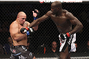 CALGARY, CANADA - JULY 21: (R-L) Cheick Kongo lands a punch to the chest of Shawn Jordan during their heavyweight bout at UFC 149 inside the Scotiabank Saddledome on July 21, 2012 in Calgary, Alberta, Canada.  (Photo by Nick Laham/Zuffa LLC/Zuffa LLC via Getty Images)