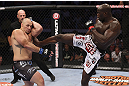 CALGARY, CANADA - JULY 21: (R-L) Cheick Kongo lands a kick to the body of Shawn Jordan during their heavyweight bout at UFC 149 inside the Scotiabank Saddledome on July 21, 2012 in Calgary, Alberta, Canada.  (Photo by Nick Laham/Zuffa LLC/Zuffa LLC via Getty Images)
