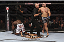 CALGARY, CANADA - JULY 21: (L-R) Cheick Kongo kneels after Shawn Jordan hit him with an accidental elbow below the belt during their heavyweight bout at UFC 149 inside the Scotiabank Saddledome on July 21, 2012 in Calgary, Alberta, Canada.  (Photo by Nick Laham/Zuffa LLC/Zuffa LLC via Getty Images)