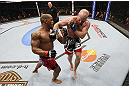 CALGARY, CANADA - JULY 21:  (L-R) Hector Lombard exchanges punches with Tim Boetsch during their middleweight bout at UFC 149 inside the Scotiabank Saddledome on July 21, 2012 in Calgary, Alberta, Canada.  (Photo by Nick Laham/Zuffa LLC/Zuffa LLC via Getty Images)