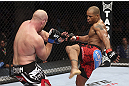 CALGARY, CANADA - JULY 21: (R-L) Hector Lombard kicks at Tim Boetsch during their middleweight bout at UFC 149 inside the Scotiabank Saddledome on July 21, 2012 in Calgary, Alberta, Canada.  (Photo by Nick Laham/Zuffa LLC/Zuffa LLC via Getty Images)
