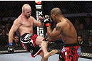CALGARY, CANADA - JULY 21: (L-R) Tim Boetsch kicks Hector Lombard during their middleweight bout at UFC 149 inside the Scotiabank Saddledome on July 21, 2012 in Calgary, Alberta, Canada.  (Photo by Nick Laham/Zuffa LLC/Zuffa LLC via Getty Images)