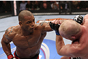 CALGARY, CANADA - JULY 21: (L-R) Hector Lombard throws a punch at Tim Boetsch during their middleweight bout at UFC 149 inside the Scotiabank Saddledome on July 21, 2012 in Calgary, Alberta, Canada.  (Photo by Nick Laham/Zuffa LLC/Zuffa LLC via Getty Images)