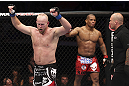 CALGARY, CANADA - JULY 21: (L-R) Tim Boetsch celebrates after three rounds fighting against Hector Lombard during their middleweight bout at UFC 149 inside the Scotiabank Saddledome on July 21, 2012 in Calgary, Alberta, Canada.  (Photo by Nick Laham/Zuffa LLC/Zuffa LLC via Getty Images)