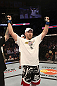 CALGARY, CANADA - JULY 21:  (L-R) Tim Boetsch celebrates after defeating Hector Lombard during their middleweight bout at UFC 149 inside the Scotiabank Saddledome on July 21, 2012 in Calgary, Alberta, Canada.  (Photo by Nick Laham/Zuffa LLC/Zuffa LLC via Getty Images)
