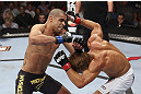 CALGARY, CANADA - JULY 21: (L-R) Renan Barao throws a punch at Urijah Faber during their UFC interim bantamweight championship bout at UFC 149 inside the Scotiabank Saddledome on July 21, 2012 in Calgary, Alberta, Canada.  (Photo by Nick Laham/Zuffa LLC/Zuffa LLC via Getty Images)