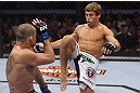 CALGARY, CANADA - JULY 21: (R-L) Urijah Faber attempts a kick to the body of Renan Barao during their UFC interim bantamweight championship bout at UFC 149 inside the Scotiabank Saddledome on July 21, 2012 in Calgary, Alberta, Canada.  (Photo by Nick Laham/Zuffa LLC/Zuffa LLC via Getty Images)