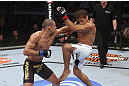 CALGARY, CANADA - JULY 21: (L-R) Renan Barao lands a punch to Urijah Faber during their UFC interim bantamweight championship bout at UFC 149 inside the Scotiabank Saddledome on July 21, 2012 in Calgary, Alberta, Canada.  (Photo by Nick Laham/Zuffa LLC/Zuffa LLC via Getty Images)