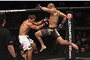 CALGARY, CANADA - JULY 21: (R-L) Renan Barao leaps toward Urijah Faber during their UFC interim bantamweight championship bout at UFC 149 inside the Scotiabank Saddledome on July 21, 2012 in Calgary, Alberta, Canada.  (Photo by Nick Laham/Zuffa LLC/Zuffa LLC via Getty Images)